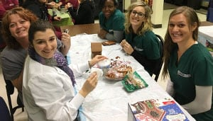 American Institute donates gingerbread houses to We Are The Children