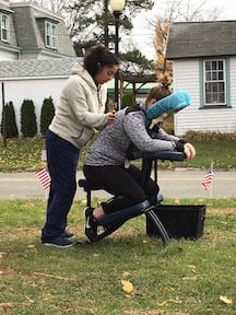 Runners in the Clifton, NJ, 5K Stampede receive complimentary massages from American Institute students