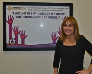 Campus President, Kim Colbert with the Purple Hands Project Pledge Poster